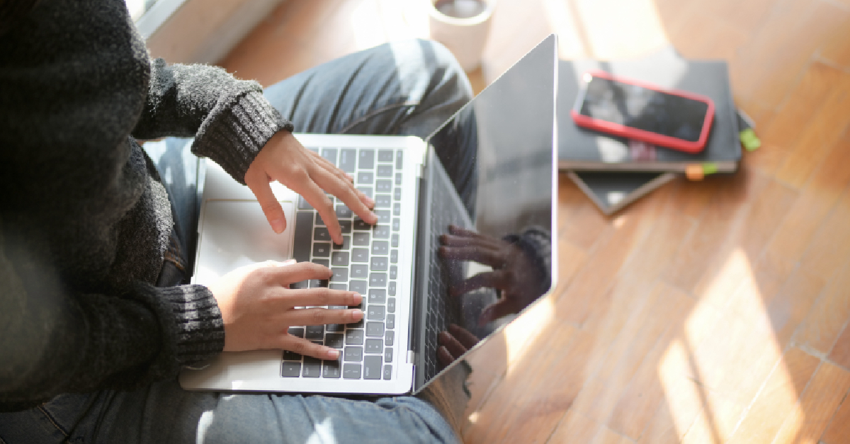 Girl in Grey Jumper Studying on Laptop at Home