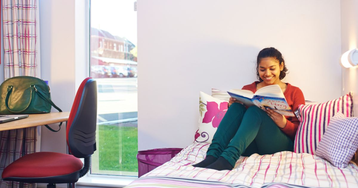 Newcastle University student in her university accommodation room